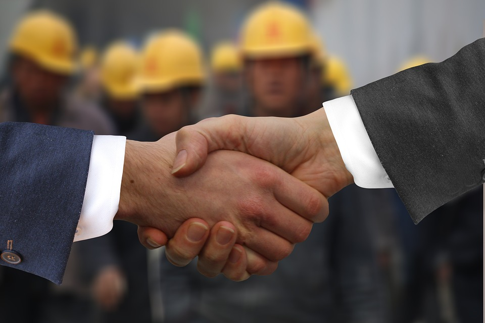 Firm business handshake
